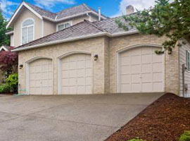 3 Bay Tan Garage Doors